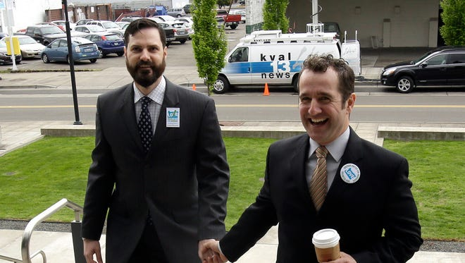 Plaintiffs Ben West, left, and Paul Rummell walk  into federal court in a case challenging Oregon's ban on same-sex marriage in Eugene, Ore., on April 23.