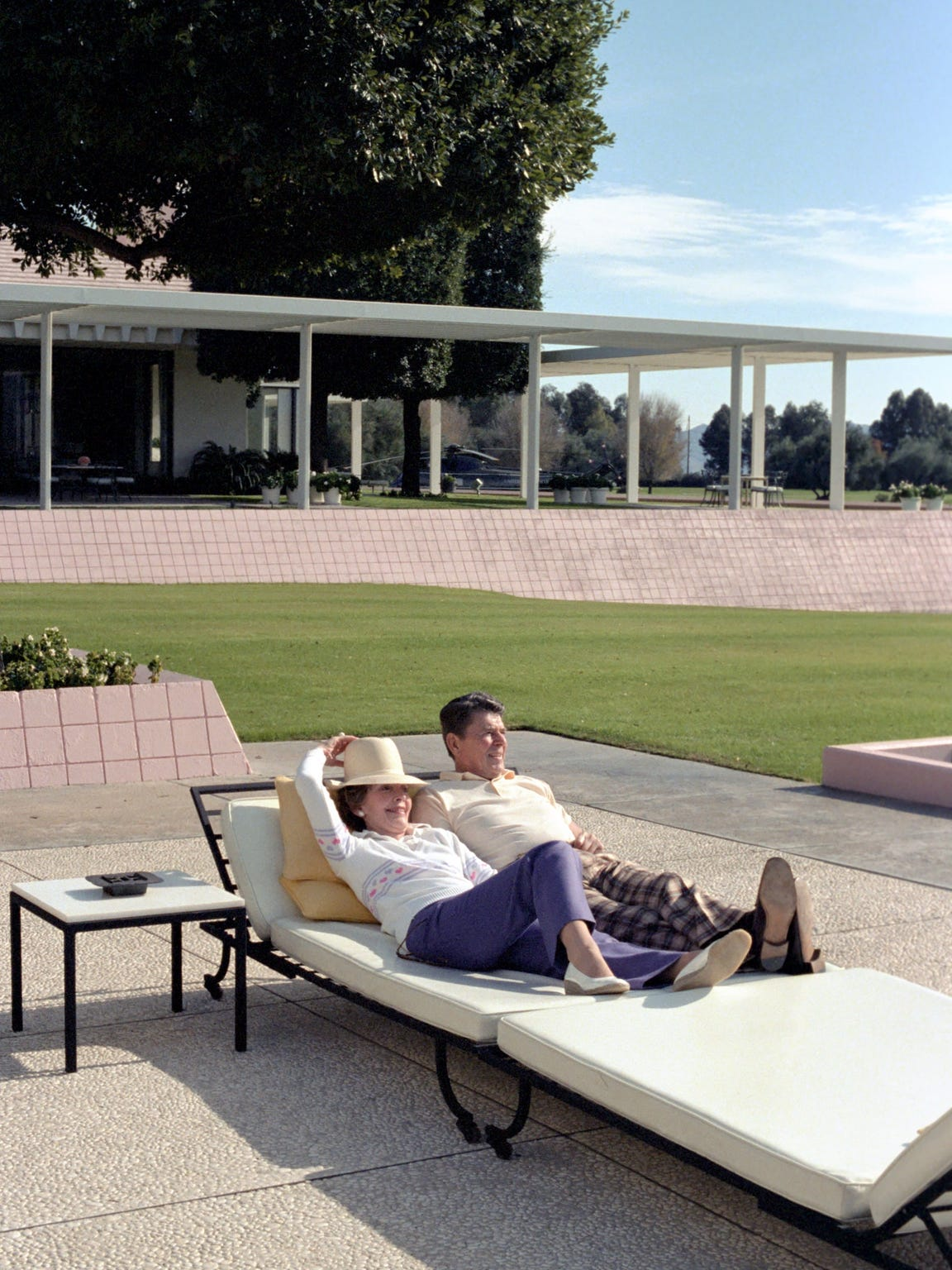Ronald and Nancy Reagan recline on the lower terrace