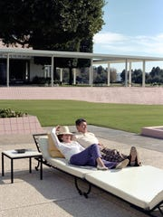 Ronald and Nancy Reagan recline on the lower terrace at Sunnylands. Marine One, the helicopter, can be seen in the background on December 31, 1981.
