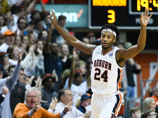 Auburn forward Anfernee McLemore (24) celebrates a three-point shot against Arkansas during the first half of an NCAA college basketball game Wednesday, Feb. 20, 2019, in Auburn, Ala. (AP Photo/Julie Bennett)