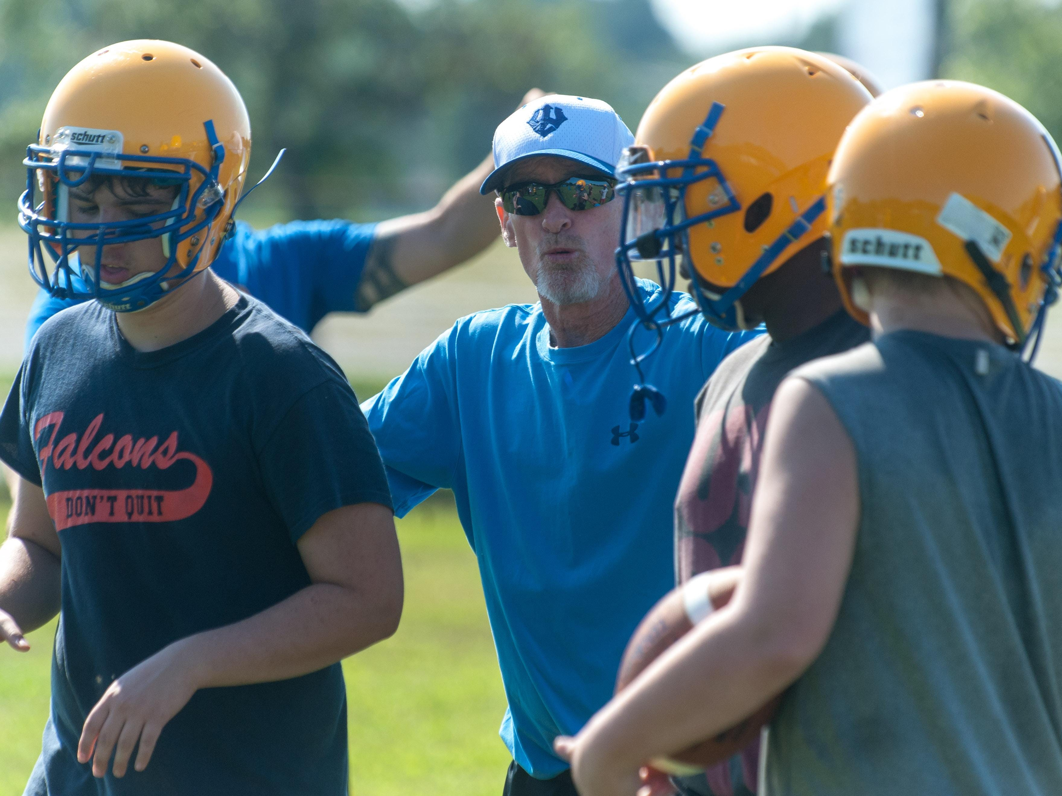 Wicomico High coaches work with linemen during the second day of practice.