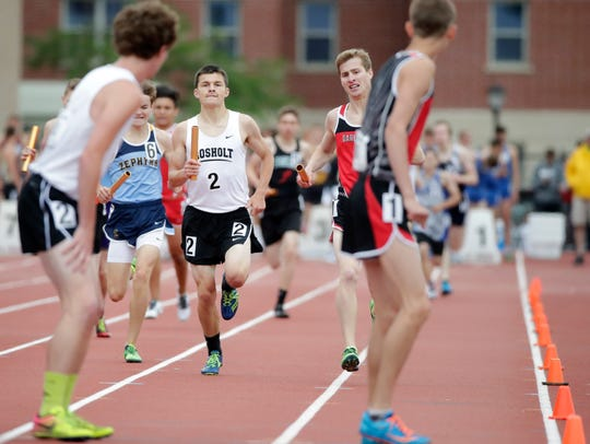 Rosholt's Josh Zick gets ready to hand the baton to Sawyer Fleming in the Division 3 3,200 meter relay during the finals of the WIAA state track and field meet Saturday at Veterans Memorial Stadium in La Crosse.