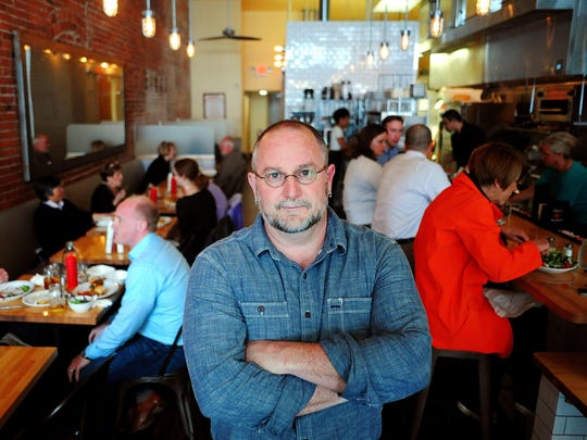 Bernard Malherbe, chef and owner of Kitchen on Court Street, is shown inside his Salem restaurant.