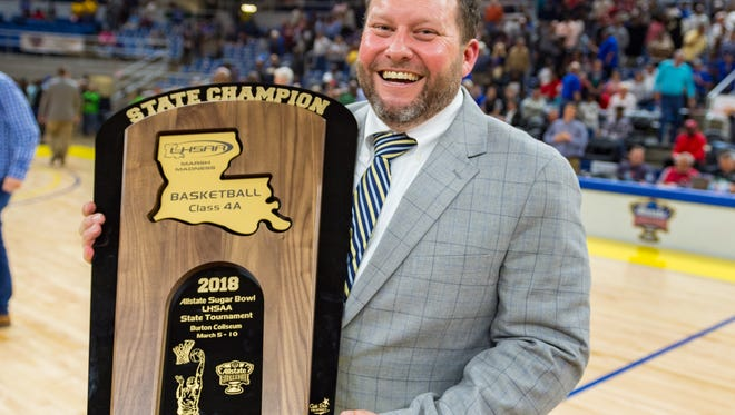 Carencro coach Christopher Kovatch smiles big after winning the Class 4A state championship.