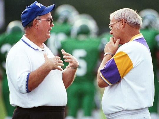 Bolton coach Brownie Parmley (left) and ASH coach Butch Stoker have a word together before their teams take each other on in a jamboree.
