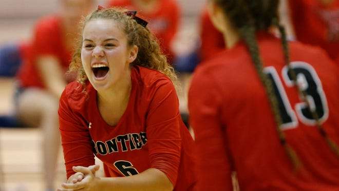 Hallie Carter of Frontier celebrates with her teammates after a Frontier point against Harrison Tuesday, August 22, 2017, in West Lafayette. The Harrison swept Frontier 25-13, 25-16, 25-13.