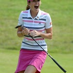 Paula Creamer celebrates after holing an eagle putt to seal victory in a playoff against Azahara Munoz of Spain at the HSBC Women's Champions at the Sentosa Golf Club.