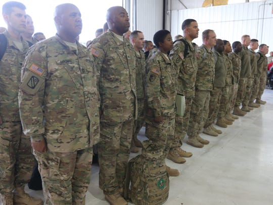 Smyrna-based Tennessee Army National Guard 1176th Transportation Company is welcomed home from Afghanistan on Dec. 7, 2014, after being deployed for nine months.