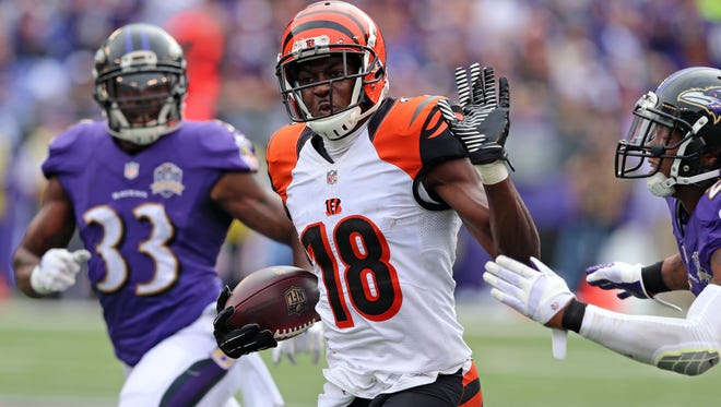 Cincinnati Bengals wide receiver A.J. Green (18) catches a pass and runs for a fourth quarter touchdown against the Baltimore Ravens  at M&T Bank Stadium.