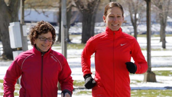 Terri Myers, left, and Amanda Smith-Socaris run alongside each other at Clute Park in Watkins Glen.