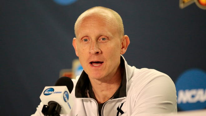 Xavier Musketeers head coach Chris Mack answers question during a media day press conference ahead of Xavier's Elite 8 game with the 1-seed Gonzaga at the SAP Center in San Jose, Calif., on Friday, March 24, 2017. Xavier advanced to the Elite 8 with a 73-71 upset win over the 2-seeded Arizona Wildcats.