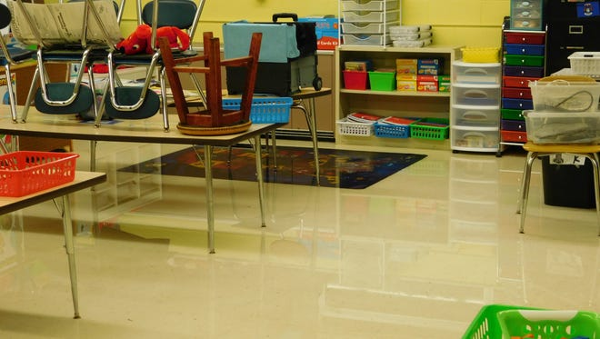 Some flooding in St. Edith Catholic School kept younger students out of class Tuesday. Older students reported to school.