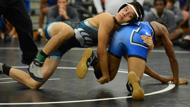 Bayside's Timothy Tran (left) wrestles Zacharie Kianes of Heritage on Day 1 of the Barbara Pill Memorial Wrestling Tournament.