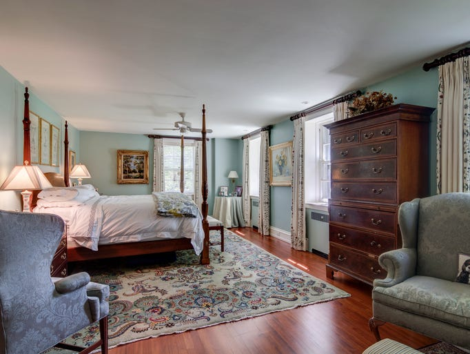 The second floor houses a self-contained master suite,