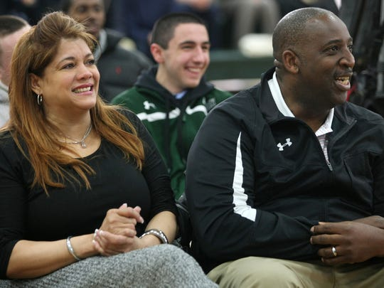 Karl Towns' parents Jacqueline Cruz Towns and Karl Towns Sr. watch as their son is awarded the Gatorade National Player of the Year in 2014.
