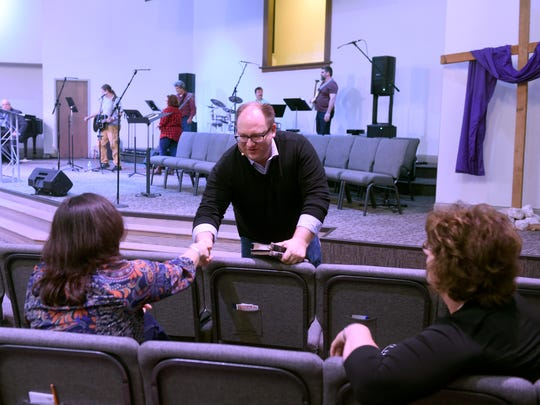 Rev., Andy Weaver greets church members and visitors at Grace Point Church in Henderson Sunday.  The congregations of Immanuel Baptist and Audubon Baptist churches in HendersonÊhave combined over the last year to form Grace Point Church.