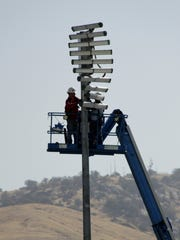 Crews install new, energy-efficient stadium lighting