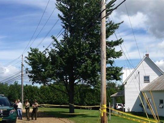 Authorities investigate the scene of multiple deaths
