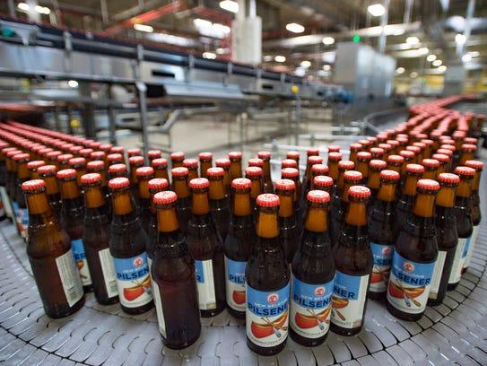Bottles move on the bottling line for packaging at