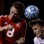 Richmond's Matt Murray, left, and Connersville's Seth Smith head the ball during a sectional soccer game Wednesday, Oct. 7, 2015, on Lyboult Field at Richmond.