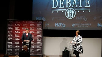 Republican Carlos Rendo, left, and Assemblywoman Sheila Oliver at Monday night's lieutenant governor debate at Montclair State University.