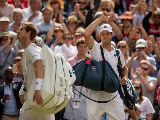 Thousand Oaks High graduate Sam Querrey (right) acknowledges