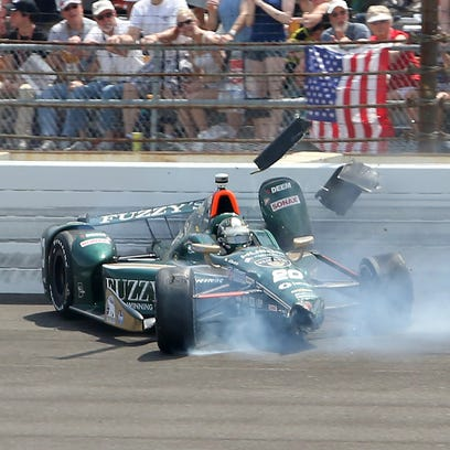 Ed Carpenter (20) of CHF Racing contacts the wall in