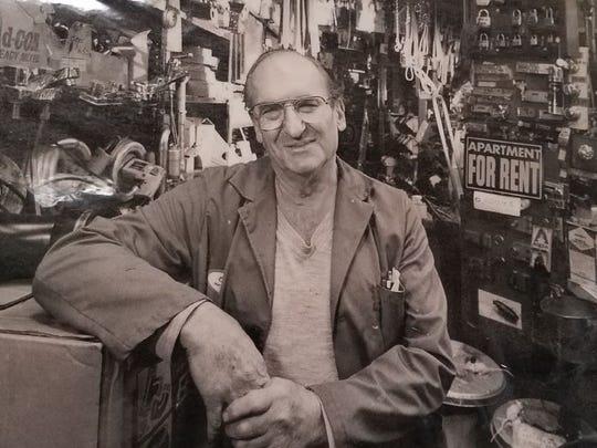 Sam Sniderman at his store, Sniderman's Hardware.