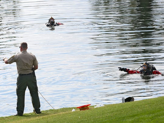 The Riverside County Sheriff's dive team scours a pond