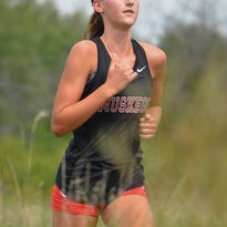 Muskego sophomore Kate Jochims pulls away for a convincing victory in the varsity girls race at the Muskego Warrior Invitational on Sept. 24 at Lake Denoon Middle School. This was her fourth win of the season.