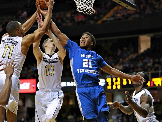 MTSU guard David Simmons goes up for a block in a game