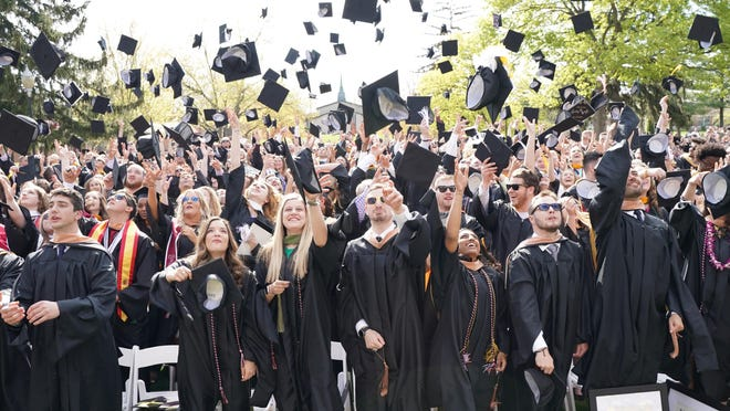 Adrian College graduates toss their mortarboards during the spring commencement ceremony May 5, 2019, on the college's Commencement Plaza. The college has scheduled a commencement ceremony for May 1, 2021, as a make-up date for both its spring and winter commencement ceremonies. The spring 2021 commencement is set for May 2, 2021.