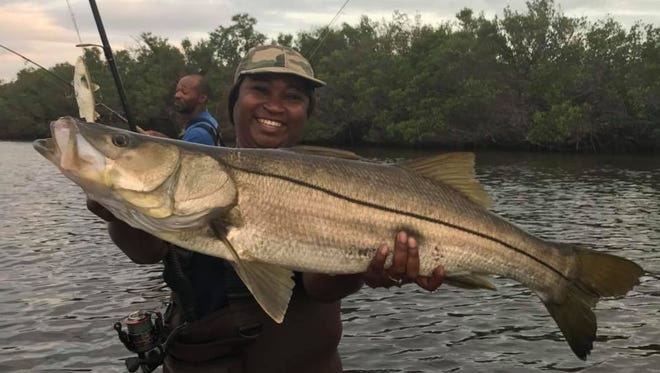 Altansas Gordon, of Fort Pierce, while wade-fishing the east shore of the Indian River Lagoon on Saturday with her brother Kevin McCoy, of Port St. Lucie, caught and released her largest snook to date, a 40-inch beast caught using a Live Target mullet.