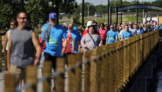 The Loop the Lake 5K recreational trail officially opens for use Saturday as bikers, runners and walkers move across the new Neenah bridge at Arrowhead Park.