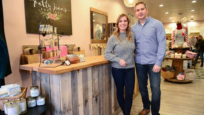 Patty Jean's Boutique owners Megan and Michael Cosman stand in their store in Berlin.