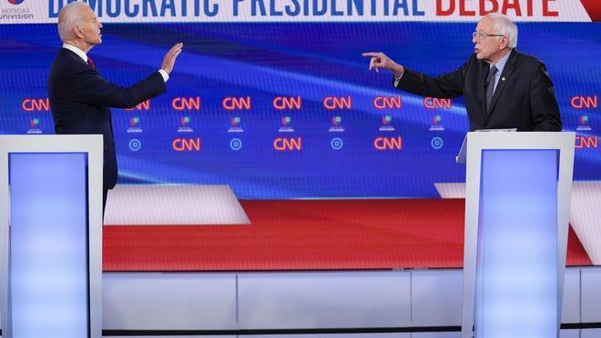 Former Vice President Joe Biden, left, and Sen. Bernie Sanders, I-Vt., right, participate in a Democratic presidential primary debate at CNN Studios in Washington, Sunday, March 15, 2020.