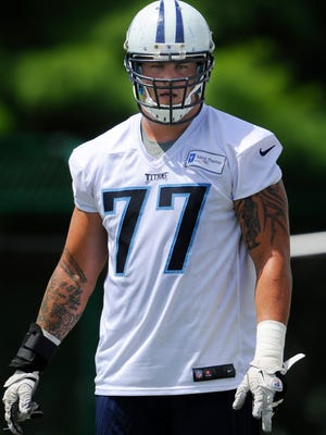 Titans tackle Taylor Lewan (77) makes his way to the next drill during practice at St. Thomas Sports Park Wednesday June 18, 2014, in Nashville, Tenn.