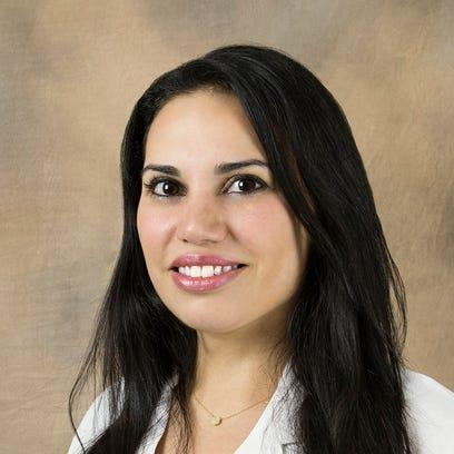 Dr. Claudia Karam