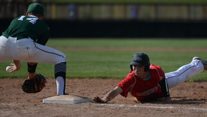 Richmond's Thomas Stanley slides back to first base as Pendleton Heights' Casey Branham fields the throw Monday at McBride Stadium in the Class 4A Sectional 9 final.