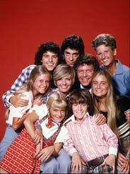 "The cast of ""The Brady Bunch"": (front row) Susan Olsen,"