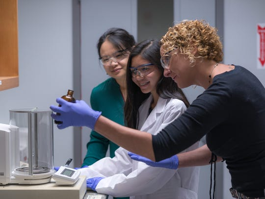 (From left to right) Huan Chen from the MagLab, Leon High School student Madeline Feiock and Amy McKenna conduct research at the MagLab.