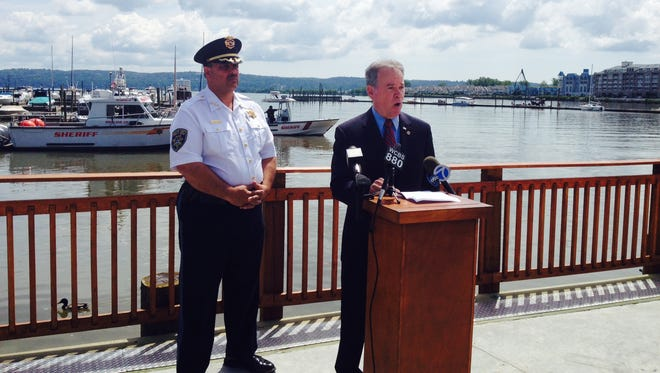 Rockland County Executive Ed Day and Rockland Sheriff Louis Falco, at left, unveil plans for increased boat patrols and other safety measures on Hudson River in light of construction equipment in the river for the new bridge, June 27, 2014. They are speaking from Cornetta's marina in Piermont with the  sheriff's Marine Unit in the background.