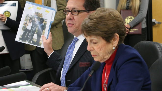 Attorneys Reginald Garcia, left, and Pat Bliss speak to the Florida Commission on Offender Review at Felix Garcia last parole hearing in 2014.