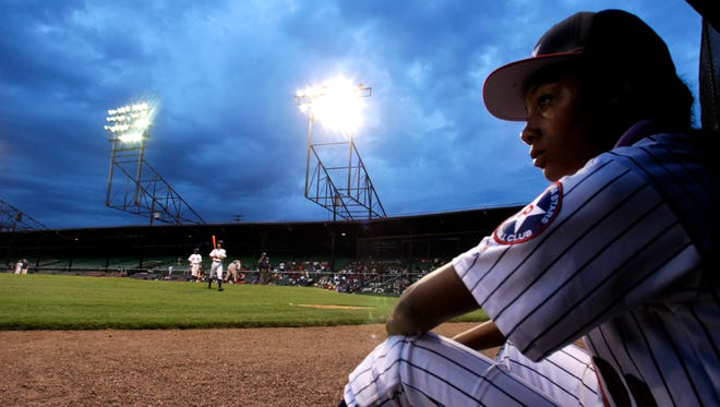 Mo'ne Davis, of the Anderson Monarchs, watches her teammates as the play against the Willie Mays RBI Birmingham team at Rickwood Field June 24 in Birmingham, Ala.