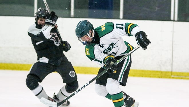 Montgomery's Michael Hrudowsky moves the puck against Bridgewater-Raritan at Pro Skate Ice Arena on Wednesday.