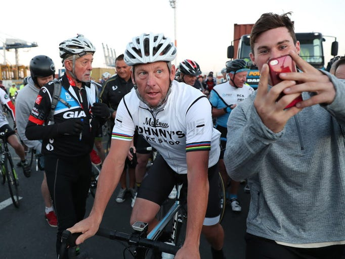 Lance Armstrong heads out with cyclists in Auckland,