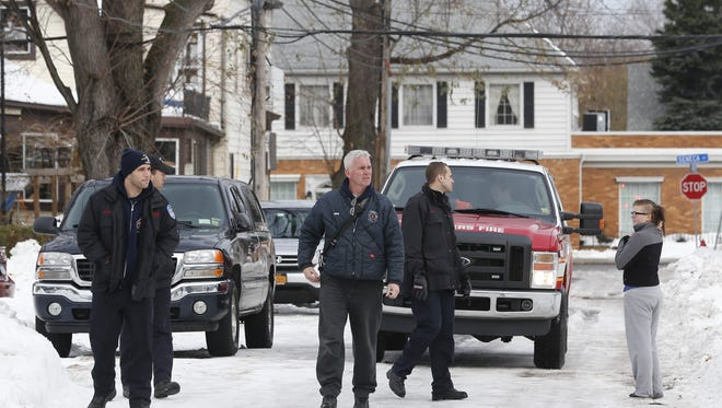 Yonkers Fire Department personnel survey houses in south Buffalo, N.Y. for structural damage on Sunday, Nov. 23, 2014. Western New York continues to dig out from the heavy snow dropped this week by lake-effect snowstorms. (AP Photo/Mike Groll)