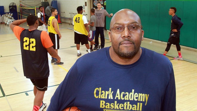 Clark Academy coach Anthony Gaines in the gym getting his team ready for the state semifinals March 9, 2016.