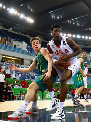 Josh Jackson of the United States controls the ball against Matthew Owies of Australia during the FIBA U17 World Championships Final match between Australia and the United States of America at the Hamdan Sports Complex on August 16, 2014 in Dubai, United Arab Emirates.