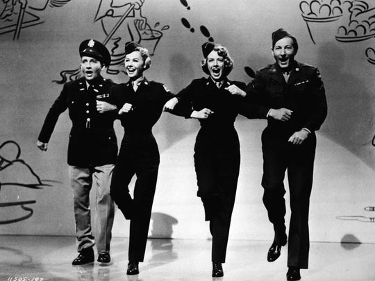 """Singer Rosemary Clooney, second from right,  dances with, from left to right, Bing Crosby, Vera-Ellen, and Danny Kaye in this 1954 photo from the film """"White Christmas."""" (AP Photo)"""